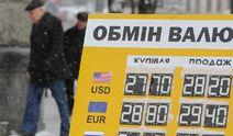 Совет НБУ назвал девальвацию гривни временным явлением