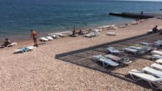 Як туристичний сезон добігає кінця у Криму: фото з найпопулярніших пляжів півострова