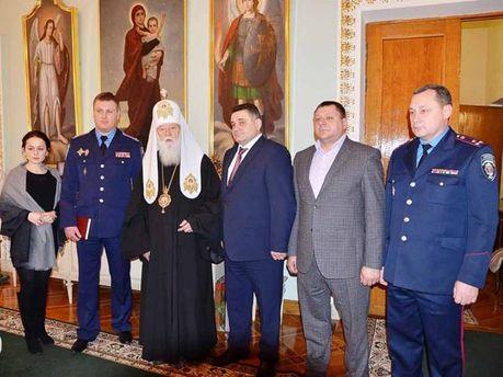 Патриарх Филарет с киевскими милиционерами