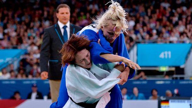 Юлія Галінська (в синьому) проти Кармен Брюссіг