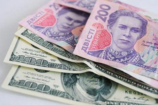 Гривня і долар